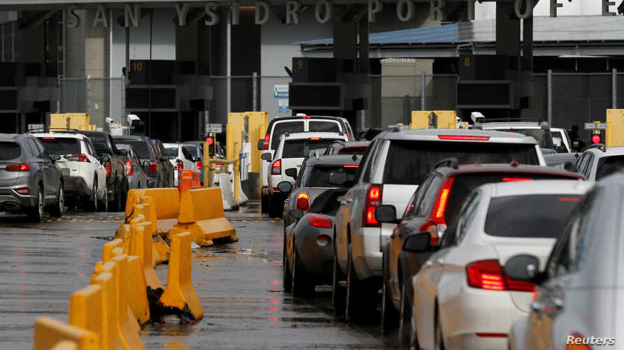 Cars line up to cross into the U.S. at the Mexico-U.S. San Ysidro border crossing after the Mayor of Tijuana restricted visits…