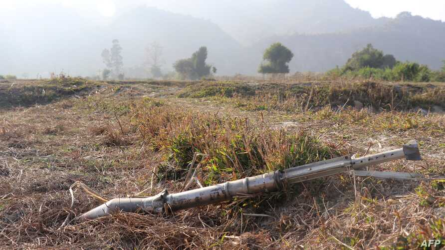 FILE - A Feb. 21, 2019, photo shows an unexploded mortar lying on a field in Rathedaung township after fighting in Rakhine state between Myanmar's military and the Arakan Army, an ethnic Rakhine force.
