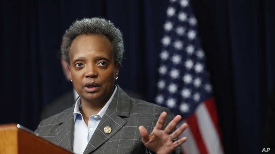 Chicago mayor Lori Lightfoot responds to a question after Illinois Gov. J.B. Pritzker announced a shelter in place order to combat the spread of the Covid-19 virus, during a news conference, March 20, 2020, in Chicago.