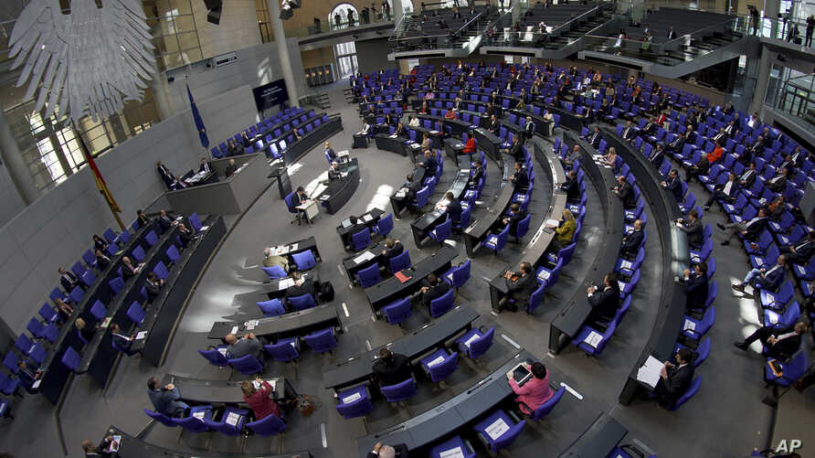 Due to the new coronavirus outbreak, German lawmakers keep distance during a session of the lower house of the German Parliament, the Bundestag, at the Reichstag building in Berlin, Germany, March 25, 2020.