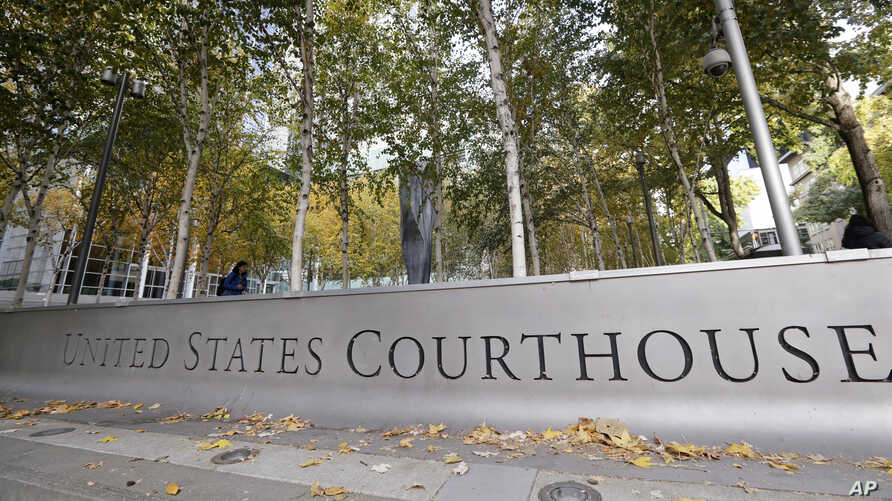 FILE - A U.S. Courthouse is seen in Seattle, Washington, fronted by a tree-lined courtyard, Nov. 6, 2019. Many U.S. immigration courts are temporarily closing or curtailing operations as the nation continues to grapple with the coronavirus pandemic.