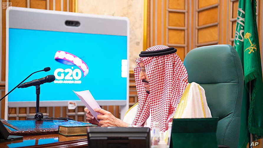 In this photo released by Saudi Press Agency, Saudi King Salman chairs a video conference of world leaders from the Group of 20 and other international bodies and organizations, from his office in Riyadh, Saudi Arabia, March 26, 2020.