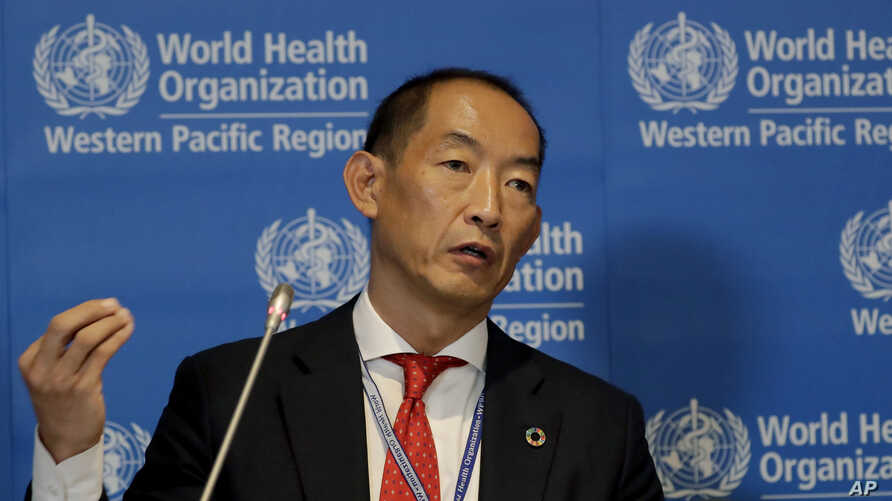 FILE - World Health Organization Regional Director for Western Pacific Takeshi Kasai addresses the media at a conference in Manila, Philippines, Oct. 7, 2019.