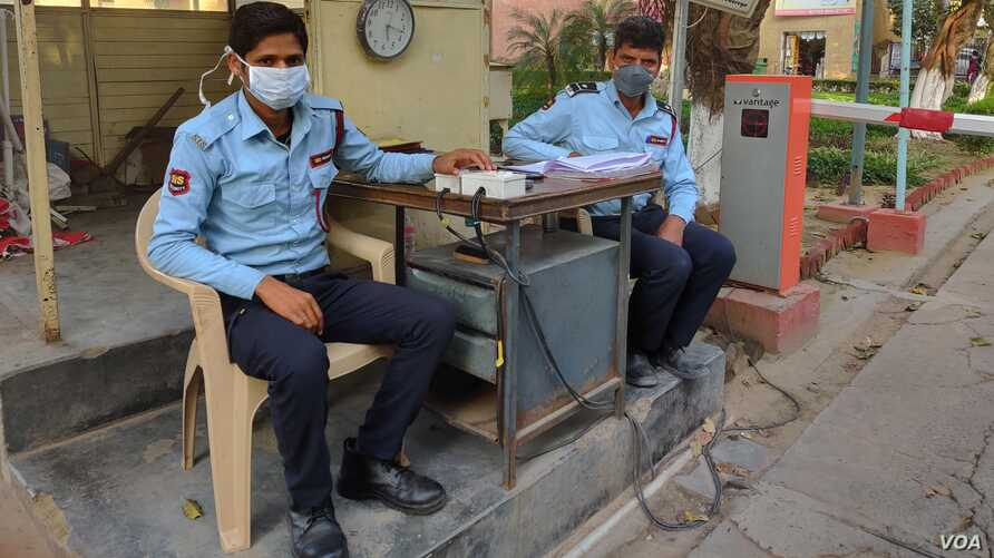 Security guards wear masks hoping it will save them from the coronavirus as the number of recorded infections in India spikes in the last week to 73. (Anjana Pasricha/VOA)