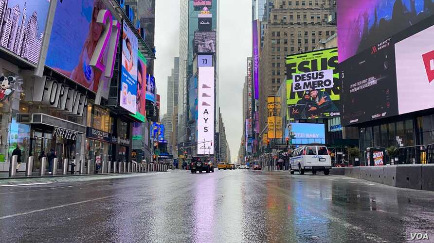 Times Square is eerily empty as most New Yorkers are teleworking these days. (Photo: Celia Mendoza /VOA)