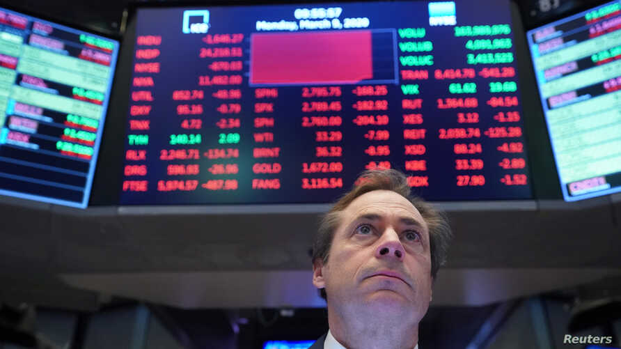 A trader works on the floor of the New York Stock Exchange (NYSE) in New York, March 9, 2020.