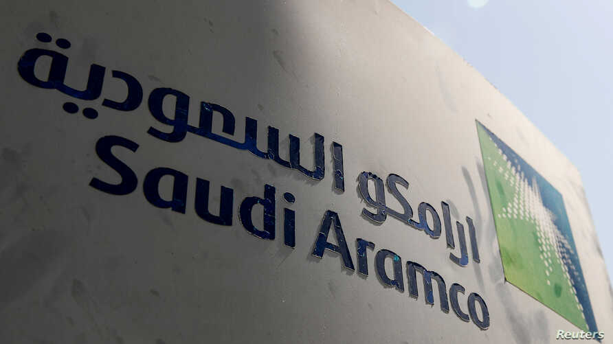 FILE - Saudi Aramco logo is pictured at the oil facility in Khurais, Saudi Arabia, Oct. 12, 2019.