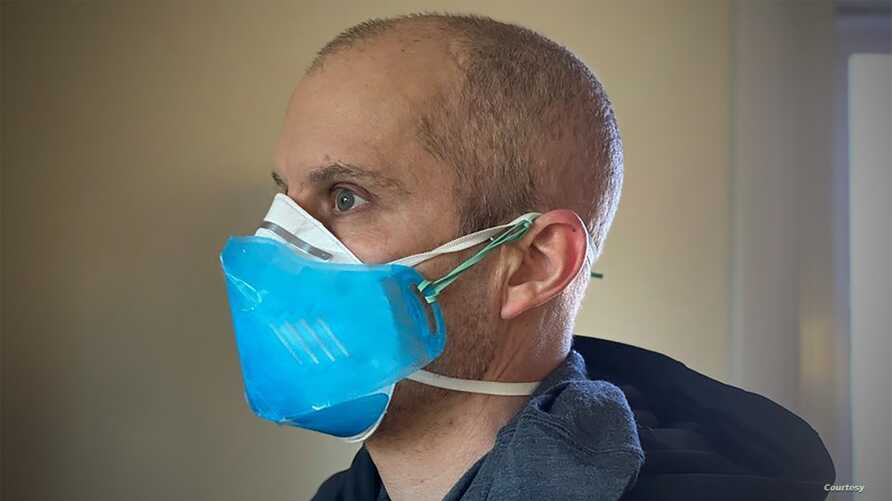 Jeremy Filko of Virginia wears one of his 3D-printed shields over a medical mask. (Photo courtesy of Jeremy Filko)