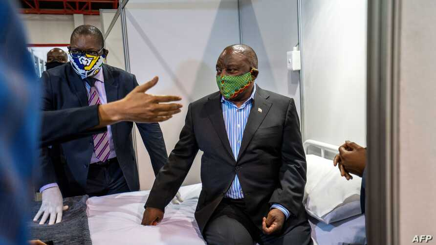 South African President Cyril Ramaphosa visits the COVID-19  coronavirus treatment facilities at the NASREC Expo Centre in…