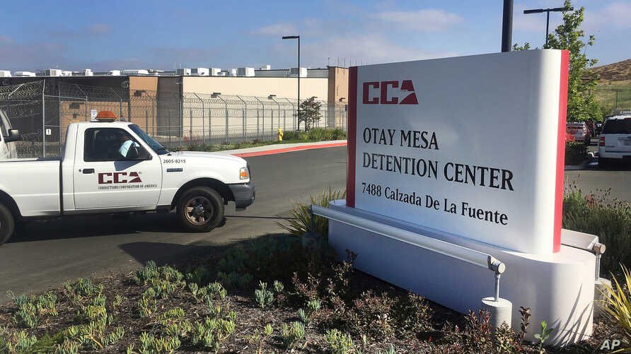 FILE - A vehicle drives into the Otay Mesa detention center in San Diego.