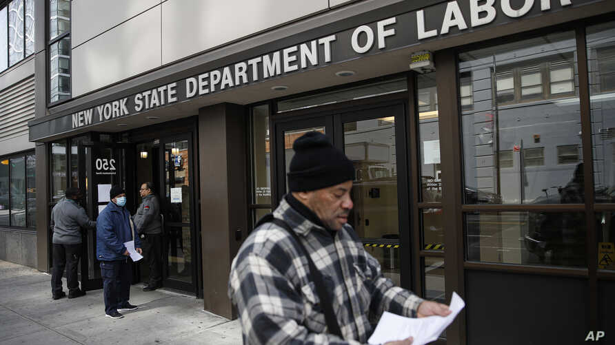 Visitors to the Department of Labor are turned away at the door by personnel due to closures over coronavirus concerns in New York, March 18, 2020.