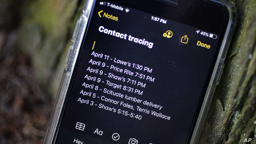 A smartphone belonging to Drew Grande, 40, of Cranston, R.I., shows notes he made for contact tracing Wednesday, April 15, 2020…