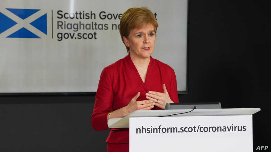A handout picture released by the Scottish Government, April 6, 2020, shows Scotland's First Minister Nicola Sturgeon speaking during the daily briefing on the novel coronavirus COVID-19 outbreak, at St. Andrew's House, Edinburgh.