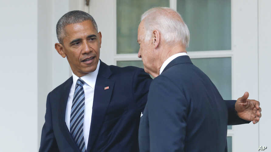FILE - Then-President Barack Obama, accompanied by then-Vice President Joe Biden, walks back to the Oval Office after speaking in the Rose Garden of the White House, in Washington, Nov. 9, 2016.