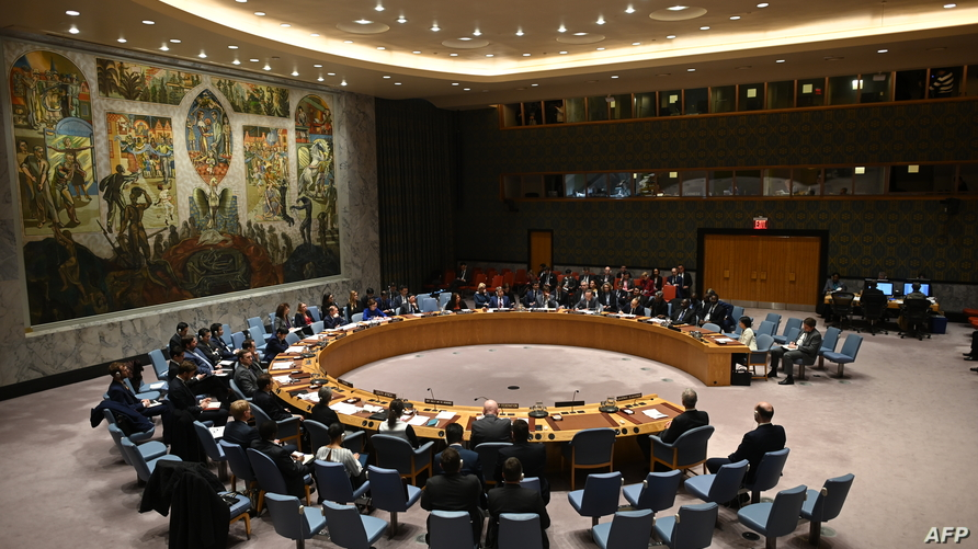 (FILES) In this file photo German Foreign Minister Heiko Maas (C) speaks at a UN Security Council meeting at United Nations…