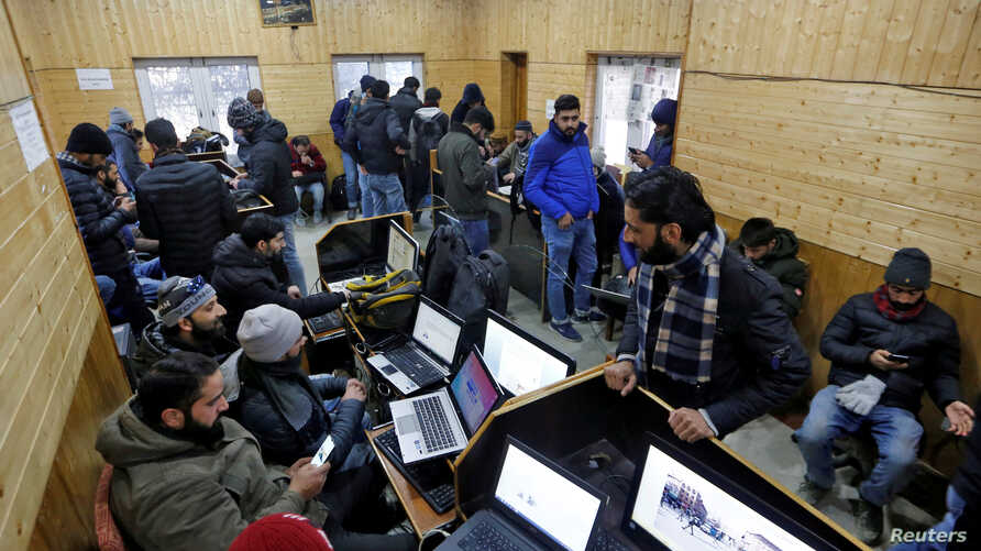 FILE PHOTO: Journalists use the internet as they work inside a government-run media centre in Srinagar January 10, 2020…