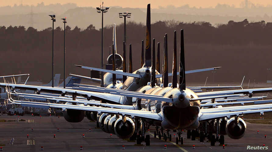FILE - Airplanes are parked at the airport in Frankfurt, Germany, March 15, 2020.