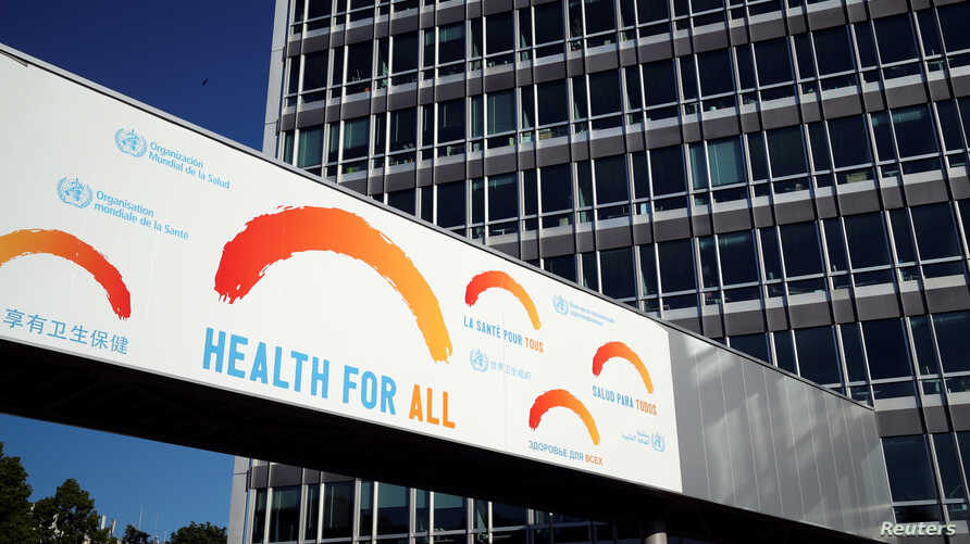 A banner is pictured at the headquarters of the World Health Organization (WHO) during the World Health Assembly (WHA)…