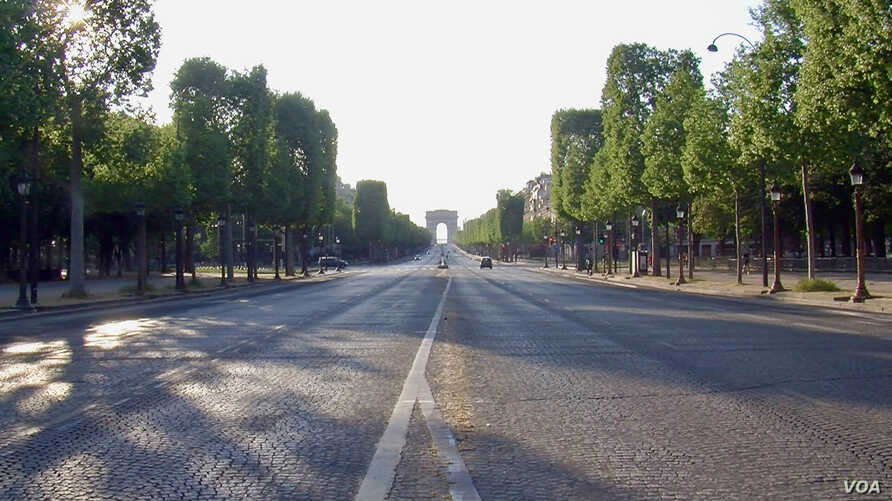 A nearly empty Champs Elysees avenue is seen in central Paris, France. French are worried about life after lockdown. (Lisa Bryant/VOA)