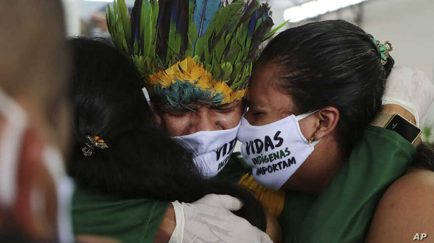 Relatives cry during the funeral of Kokama Chief Messias Martins Moreira, who died of COVID-19, during his burial service at the Park of Indigenous Nations in Manaus, Brazil, May 14, 2020.