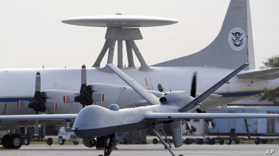FILE - This Nov. 8, 2011 file photo shows a Predator B unmanned aircraft taxis at the Naval Air Station in Corpus Christi,…
