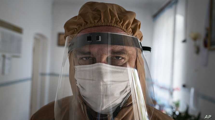 Dr. Ivan Venzhynovych, wearing special suit to protect against coronavirus
