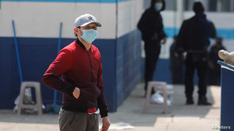 Guatemalan migrants who arrived in the country on U.S. deportation flights wear protective masks at a temporary shelter, as the spread of the coronavirus disease (COVID-19) continues in Guatemala City, April 18, 2020.