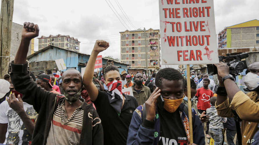 Protesters demonstrate against police brutality, in the Mathare slum, or informal settlement, of Nairobi, Kenya Monday, June 8,…