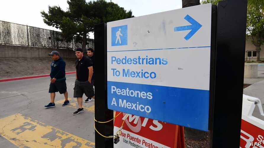 A trio of young men arrive in the US after crossing the Otay Mesa Port of Entry at the US-Mexico border in San Diego, California on June 8, 2019.   US President Donald Trump touted on Saturday his last-minute deal averting tariffs on Mexico, a plan…