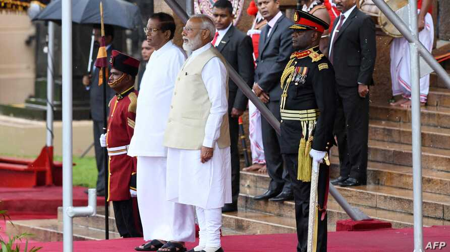 Indian Prime Minister Narendra Modi (C) and Sri Lankan President Maithripala Sirisena (L) attend a welcoming ceremony for Modi at the Presidential Secretariat, in Colombo on June 9, 2019.  India's Prime Minister Narendra Modi on June 9 made an…
