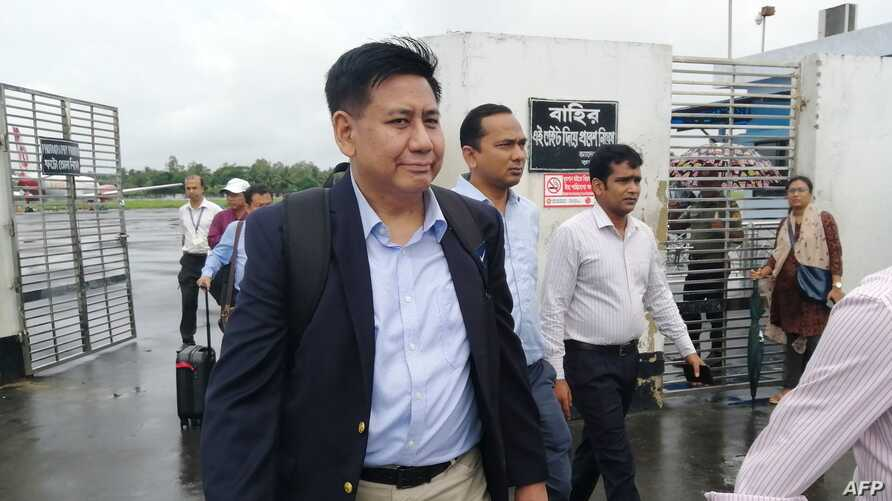 Members of the Myanmar delegation team arrive at the airport in Cox's Bazar in southern Bangladesh on July 27, 2019, ahead of expected meetings with Rohingya leaders to inform them of measures they have taken for their return to Rakhine. Security at…