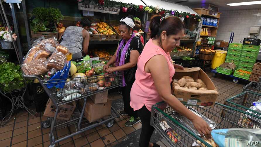 People on low-incomes and retirees choose food at the World Harvest Food Bank after the announcement that the Trump administration reportably has plans to cut food stamps to more than three million people across the country, in Los Angeles,…