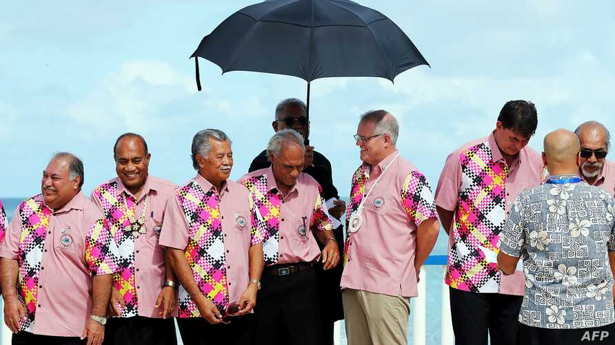Australian Prime Minister Scott Morrison, third from right, talkes with other leaders at the Pacific Islands Forum in Tuvalu, Aug. 15, 2019.