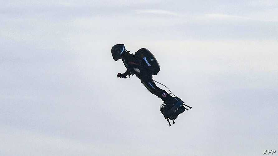 """Franky Zapata stands on his jet-powered """"flyboard"""" after he took off from Sangatte, France, Aug. 4, 2019, in an attempt to fly across the 35-kilometer (22-mile) Channel crossing in 20 minutes."""