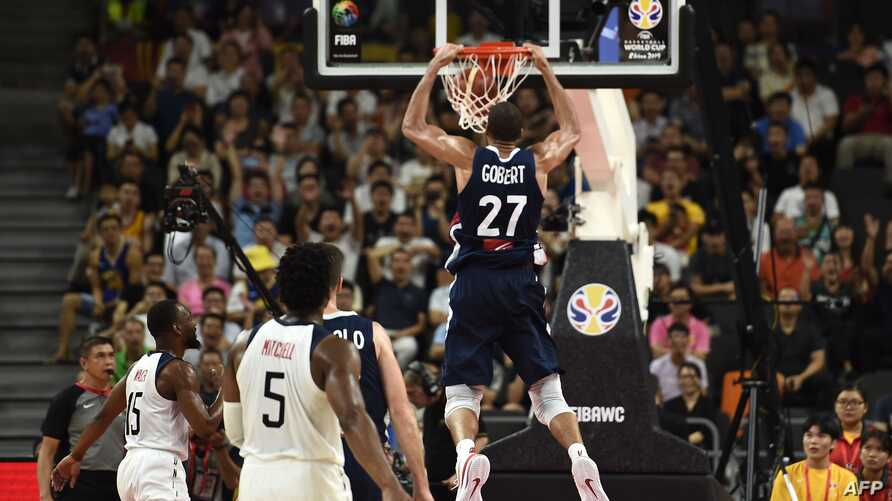TOPSHOT - France's Rudy Gobert dunks the ball during the Basketball World Cup quarter-final game between US and France in Dongguan on September 11, 2019. / AFP / Ye Aung Thu