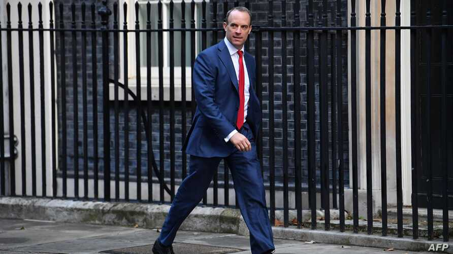 Britain's Foreign Secretary and First Secretary of State Dominic Raab arrives in Downing Street in central London on October 8,…