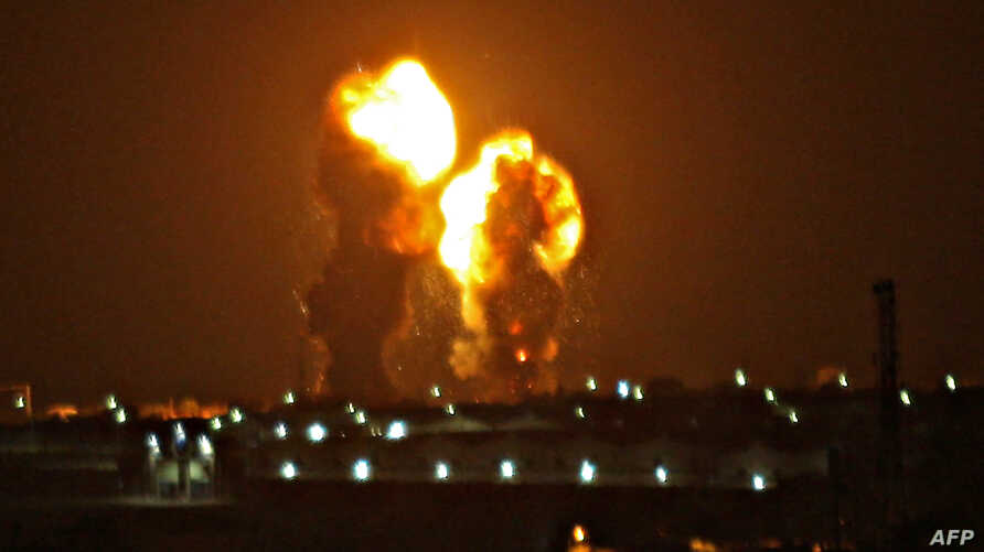 Two balls of fire are seen following an Israel airstrike in Khan Yunis in the southern Gaza Strip early on November 15, 2019. -…