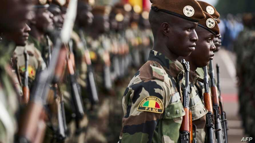 (FILES) In this file photo taken on September 22, 2018 Malian soldiers take part in celebrations marking Mali's 58th…