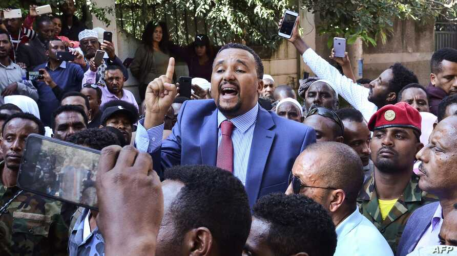 Jawar Mohammed (C), a member of the Oromo ethnic group who has been a public critic of Abiy, addresses supporters that had…