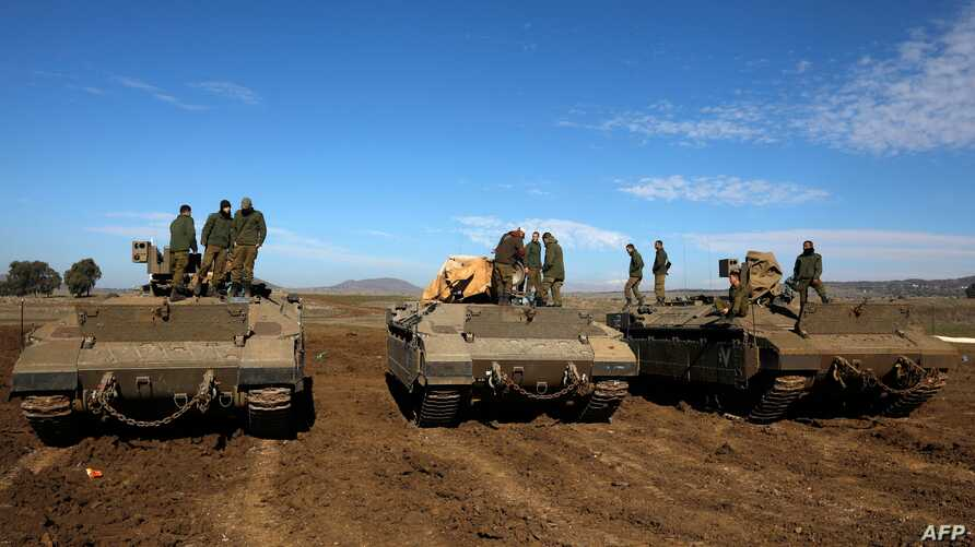 Israeli troops are pictured in the Israeli-annexed Golan Heights on the border with Syria on December 23, 2019. - A war monitor…