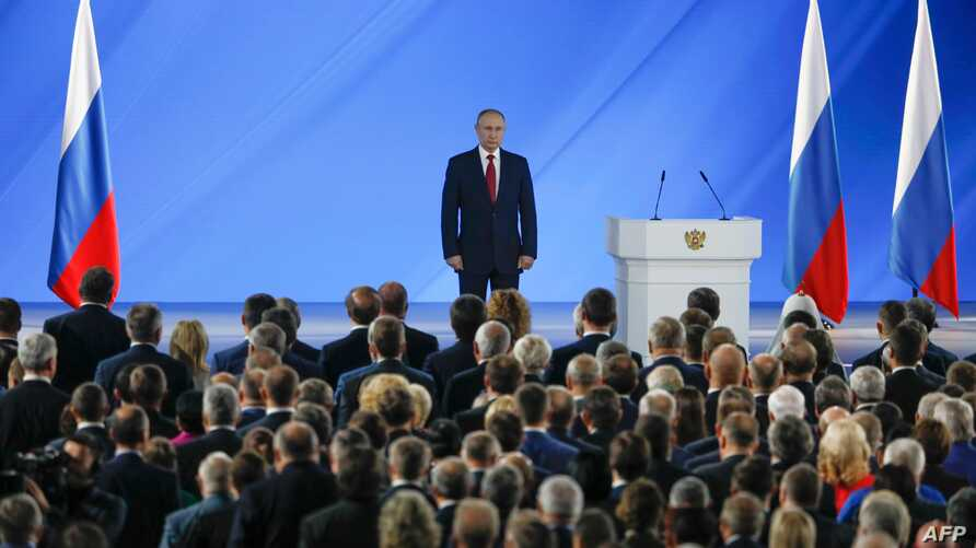 Russian President Vladimir Putin and officials listen to the national anthem after President's address to the Federal Assembly…