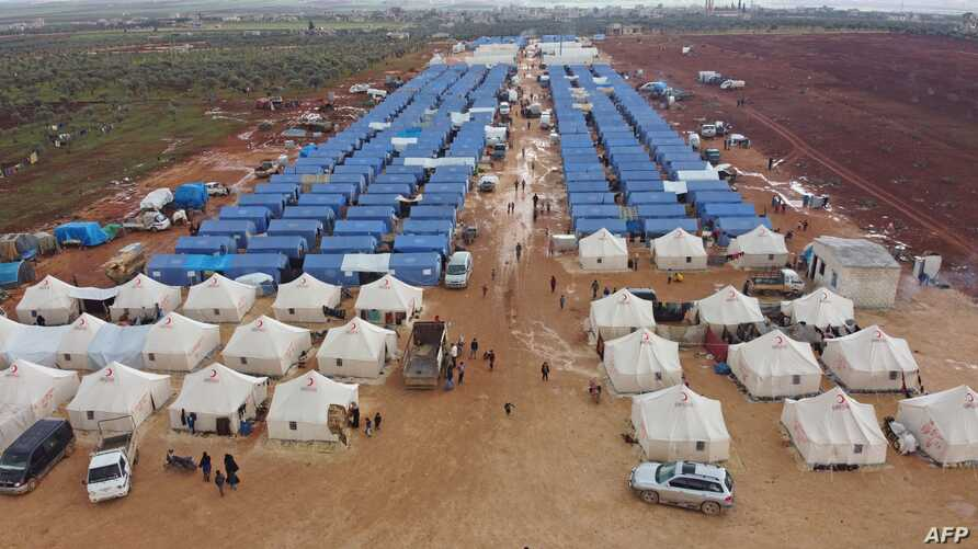 An aerial view taken on February 22, 2020 shows a newly-created camp for internally displaced people (IDP) near the town of…