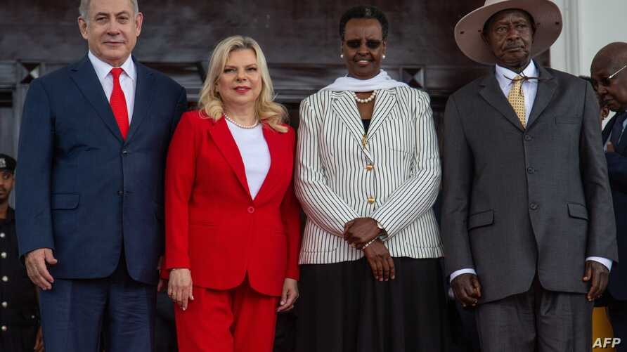 Ugandan President Yoweri Museveni (R) and Uganda's First Lady Janet Museveni (2nd R) pose for photo with Israeli Prime Minister…
