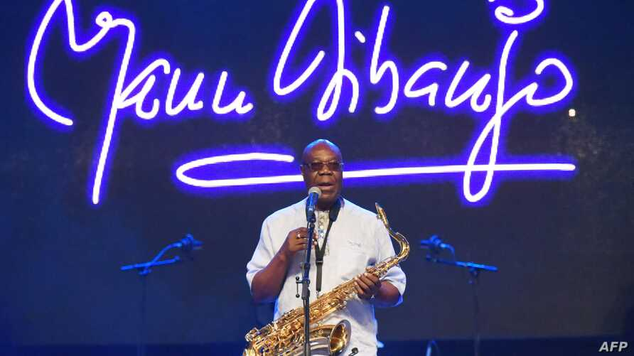 (FILES) In this file photo taken on June 30, 2018 Cameroon jazz saxophonist Manu Dibango performs during a concert at the Ivory…