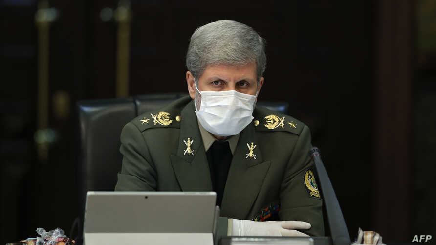 A handout picture provided by the Iranian presidency on March 11, 2020 shows Iranian Defense Minister Brigadier General Amir…
