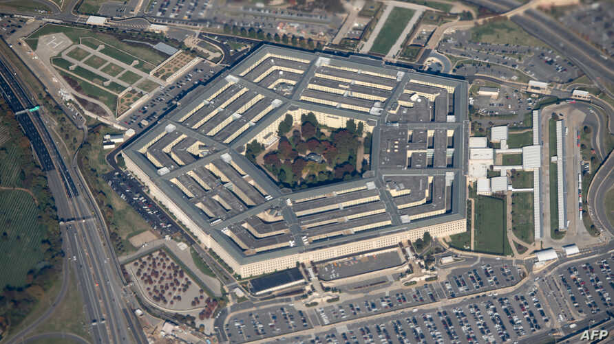 (FILES) In this file photo taken on October 30, 2018 the Pentagon is seen from an airplane over Washington, DC. - The Pentagon…