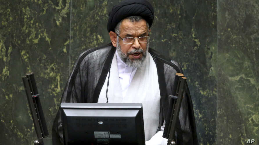 Iranian Intelligence Minister Mahmoud Alavi answers questions from lawmakers in an open session of parliament in Tehran, Iran, Tuesday, Oct. 25, 2016. Iran's intelligence minister is defending his agents' handling of a visit by a gay Utah state…