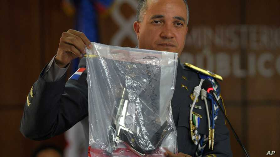 The director of the National Police, General Ney Aldrin Bautista Almonte shows the weapon that was used to shoot former Boston Red Sox slugger David Ortiz, during a press conference in Santo Domingo, Dominican Republic, June 12, 2019.