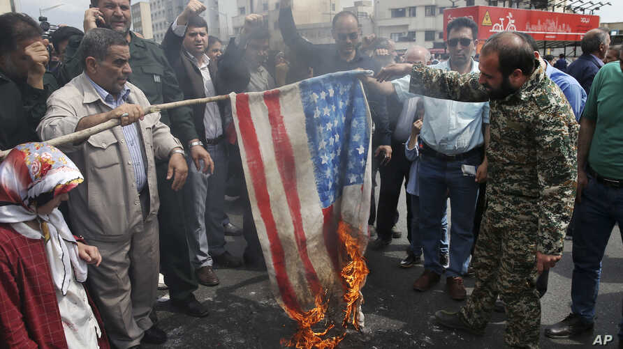 Protesters burn a representation of the U.S. flag during a rally against the U.S.'s decision to designate Iran's powerful Revolutionary Guards as a foreign terrorist organization, after their Friday prayers at the Enqelab-e-Eslami (Islamic…
