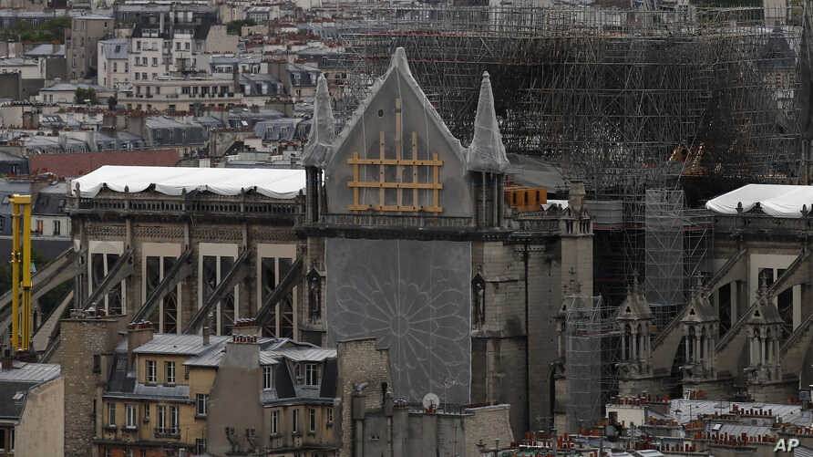 View of Notre Dame Cathedral from the top of the Tour Saint Jacques, in Paris, Friday May 31, 2019. Saint-Jacques Tower, 52-metre (171 ft) flamboyant Gothic tower is all that remains of the former 16th-century Church of Saint-Jacques-de-la-Boucherie…